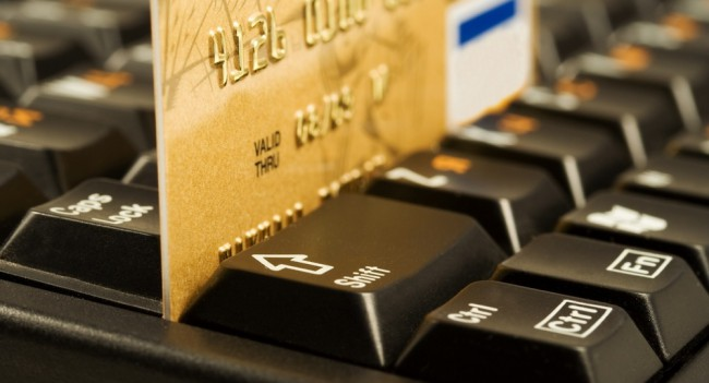 Gold credit card on computer keyboard