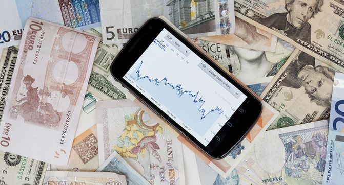 Mobile phone on banknotes