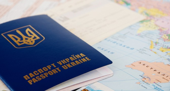 Passport and  Tickets on a World Map