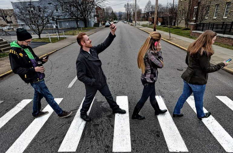 Cell Phone Crossing Road