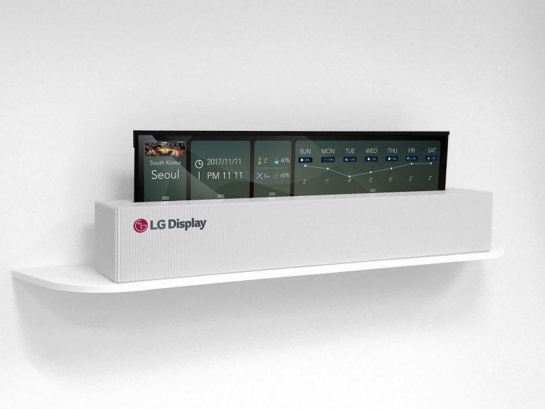 """LG привезла на CES 2018 первый в мире гибкий 65-дюймовый 4K OLED-телевизор, который умеет """"сворачиваться"""" в подставку"""