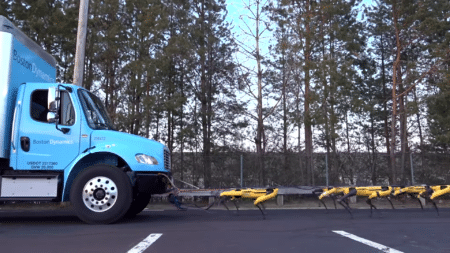 Boston Dynamics показала видео, на котором стая SpotMini буксирует грузовик