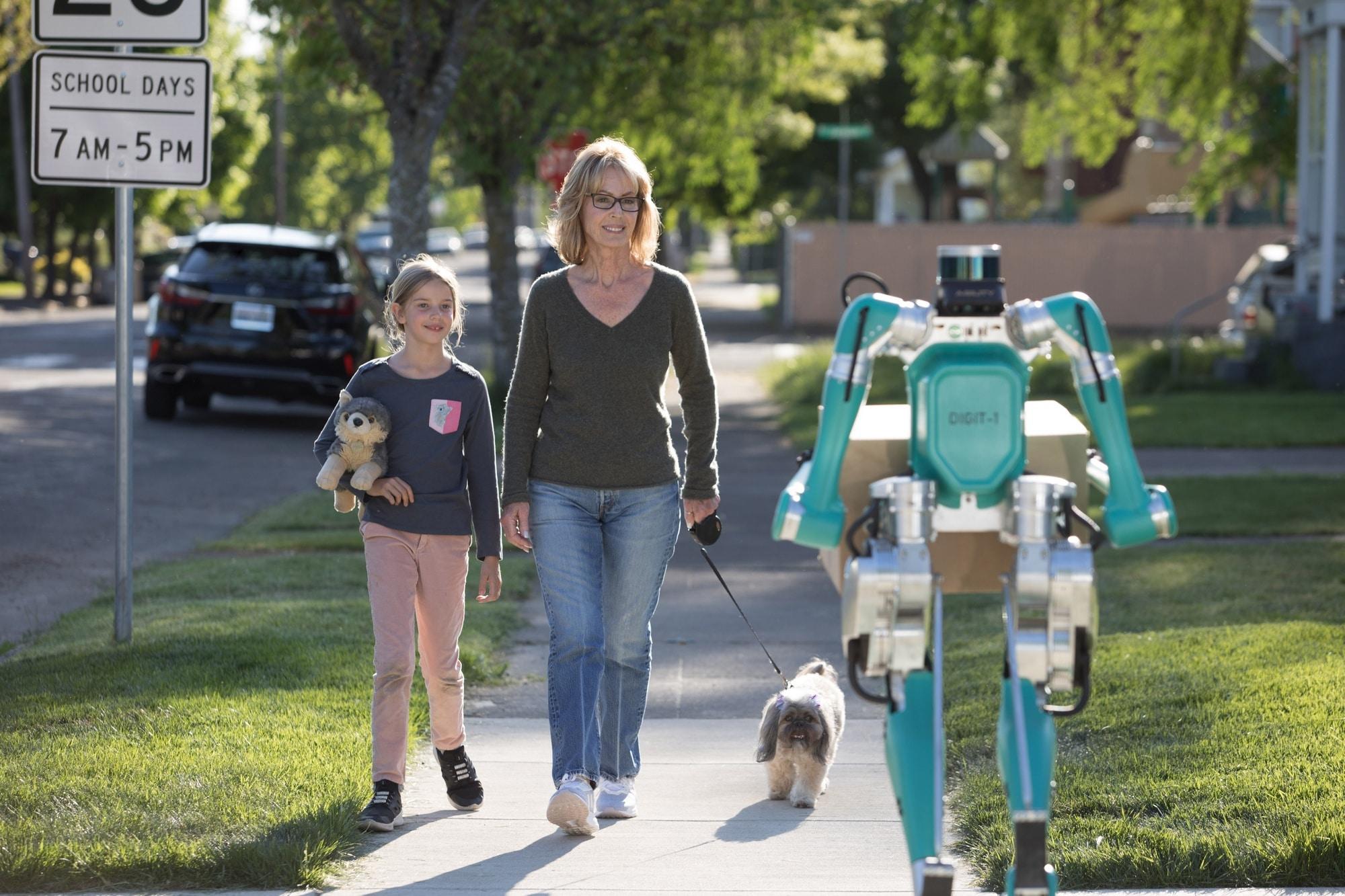 Форд представил систему доставки избеспилотного автомобиля идвуногого робота
